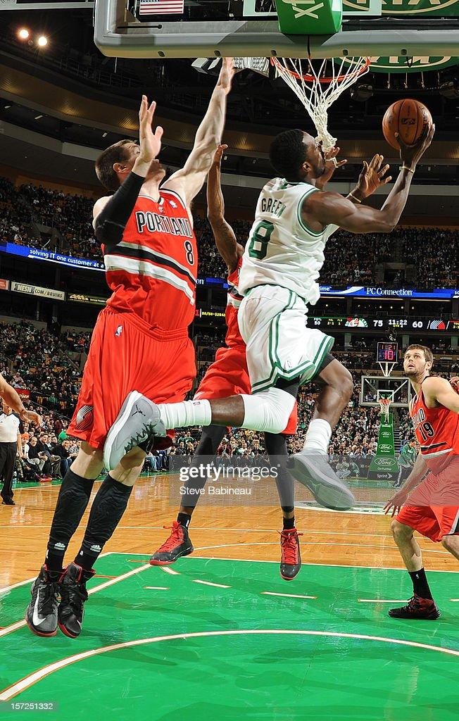 Jeff Green #8 of the Boston Celtics drives to the basket Luke Babbitt #8 of the Portland Trail Blazers on November 30, 2012 at the TD Garden in Boston, Massachusetts.
