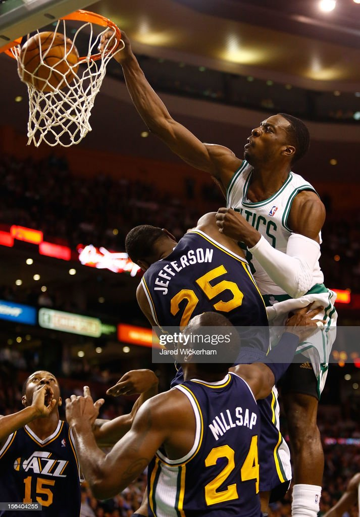 Jeff Green #8 of the Boston Celtics dunks over Al Jefferson #25 and Paul Millsap #24 of the Utah Jazz during the game on November 14, 2012 at TD Garden in Boston, Massachusetts.