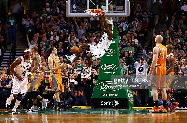 Jeff Green of the Boston Celtics dunks the ball against the Phoenix Suns during the game on January 9 2013 at TD Garden in Boston Massachusetts NOTE...