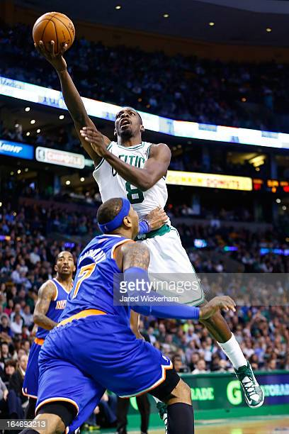 Jeff Green of the Boston Celtics goes up for a layup over Carmelo Anthony of the New York Knicks during the game on March 26 2013 at TD Garden in...