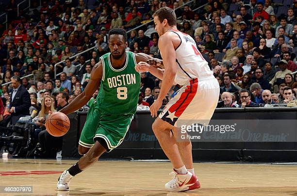 Jeff Green of the Boston Celtics handles the ball against Kris Humphries of the Washington Wizards at the Verizon Center on December 8 2014 in...