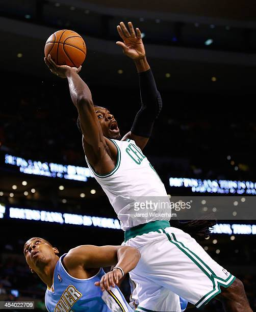 Jeff Green of the Boston Celtics is fouled on his way to the basket against the Denver Nuggets in the first quarter during the game at TD Garden on...