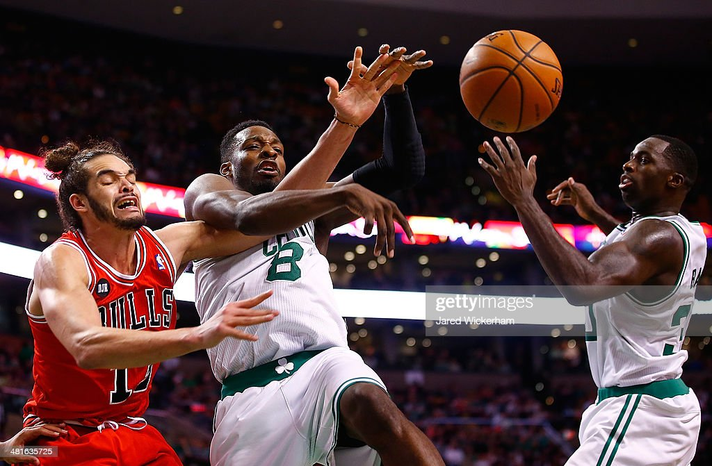 Jeff Green #8 of the Boston Celtics loses control of the ball in front of Joakim Noah #13 of the Chicago Bulls in the second half during the game at TD Garden on March 30, 2014 in Boston, Massachusetts.