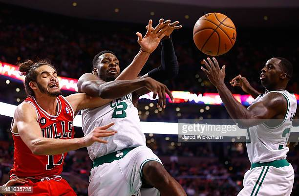 Jeff Green of the Boston Celtics loses control of the ball in front of Joakim Noah of the Chicago Bulls in the second half during the game at TD...