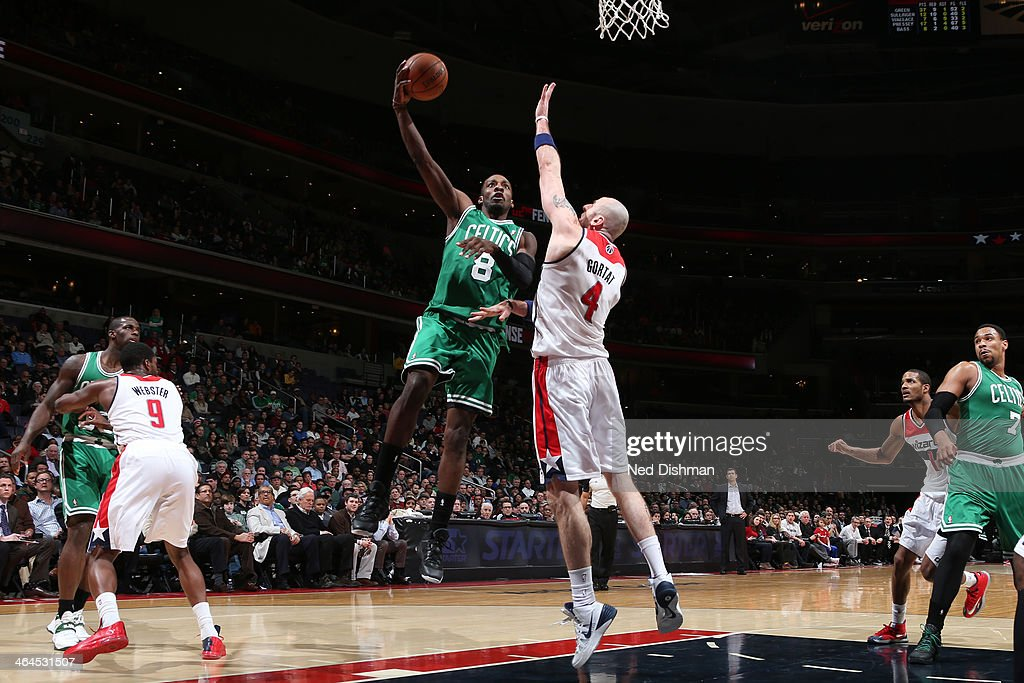 Jeff Green #8 of the Boston Celtics shoots against Marcin Gortat #4 of the Washington Wizards during the game at the Verizon Center on January 22, 2014 in Washington, DC.