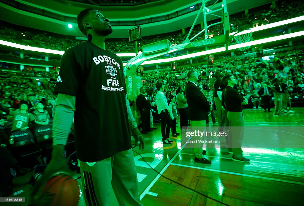 Jeff Green #8 of the Boston Celtics wears a Boston Fire Department t-shirt prior to the game against the Chicago Bulls during the game at TD Garden on March 30, 2014 in Boston, Massachusetts.