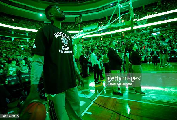 Jeff Green of the Boston Celtics wears a Boston Fire Department tshirt prior to the game against the Chicago Bulls during the game at TD Garden on...