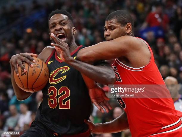 Jeff Green of the Cleveland Cavaliers drives against Cristiano Felicio of the Chicago Bulls at the United Center on March 17, 2018 in Chicago,...