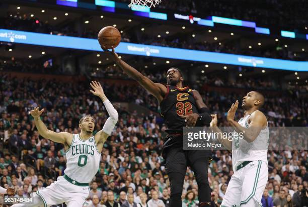 Jeff Green of the Cleveland Cavaliers drives to the basket against Jayson Tatum and Al Horford of the Boston Celtics in the first half during Game...