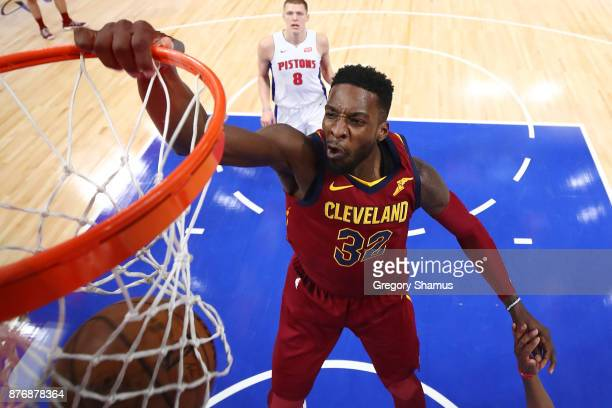 Jeff Green of the Cleveland Cavaliers dunks in front of Henry Ellenson of the Detroit Pistons during the second half at Little Caesars Arena on...