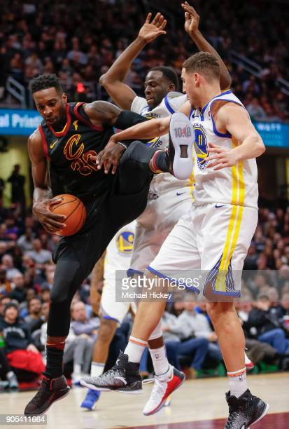 Jeff Green of the Cleveland Cavaliers gets tied up under the basket against Klay Thompson of the Golden State Warriors at Quicken Loans Arena on...