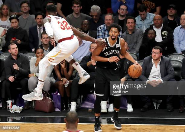 Jeff Green of the Cleveland Cavaliers jumps to defend Spencer Dinwiddie of the Brooklyn Nets in the fourth quarter during their game at Barclays...
