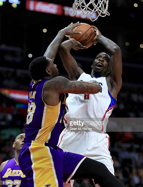Jeff Green of the Los Angeles Clippers drives to the basket against Tarik Black of the Los Angeles Lakers during an NBA game between Los Angeles...