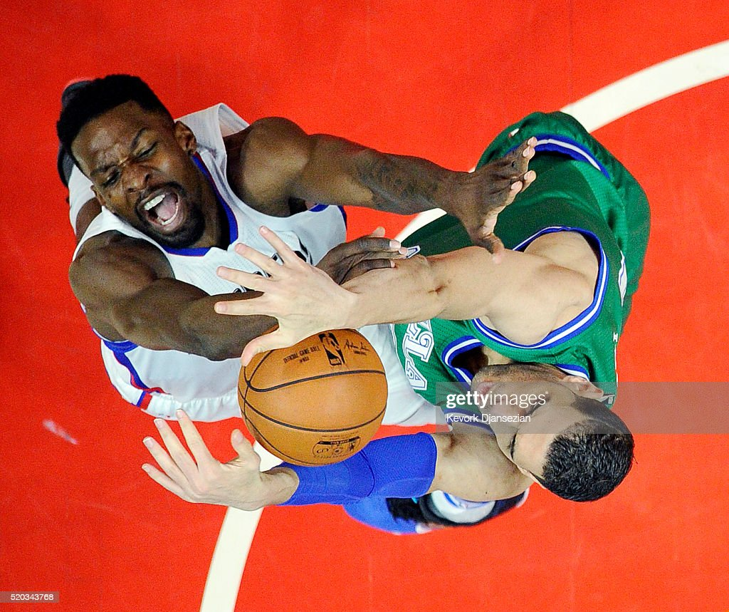 Jeff Green #8 of the Los Angeles Clippers has his layup blocked by Salah Mejri #50 of the Dallas Mavericks during the first half of the basketball game at Staples Center April 10, 2016, in Los Angeles, California.