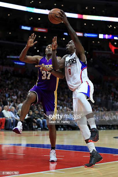 Jeff Green of the Los Angeles Clippers shoots over Metta World Peace of the Los Angeles Lakers during an NBA game between Los Angeles Clippers vs Los...