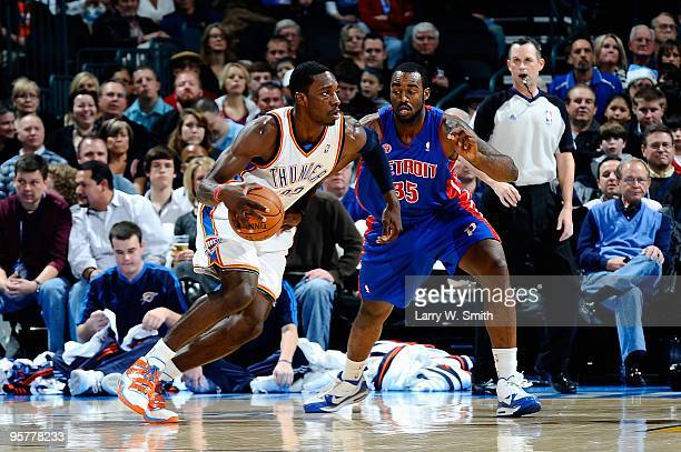 Jeff Green of the Oklahoma City Thunder drives past DaJuan Summers of the Detroit Pistons during the game on December 18 2009 at the Ford Center in...