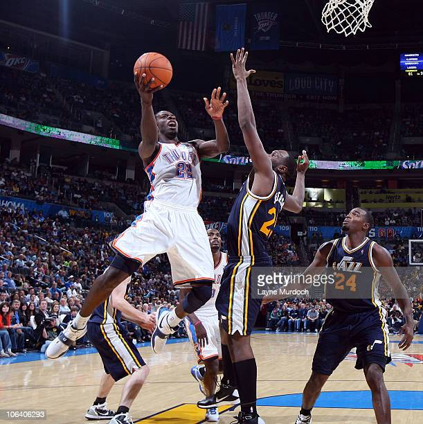 Jeff Green of the Oklahoma City Thunder shoots over Al Jefferson and Paul Millsap of the Utah Jazz on October 31 2010 at the Ford Center in Oklahoma...