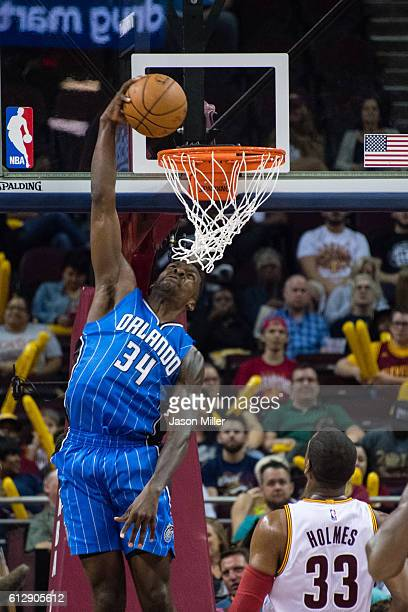 Jeff Green of the Orlando Magic dunks over Jonathan Holmes of the Cleveland Cavaliers during the second half of a preseason game at Quicken Loans...