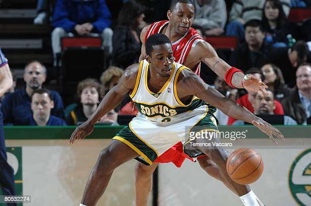 Jeff Green of the Seattle SuperSonics prepares to make a move against Tracy McGrady of the Houston Rockets on April 4 2008 at the Key Arena in...