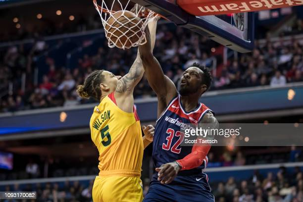 Jeff Green of the Washington Wizards dunks the ball against DJ Wilson of the Milwaukee Bucks during the first half at Capital One Arena on February 2...