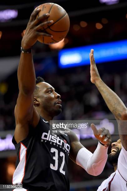 Jeff Green of the Washington Wizards shoots in front of James Johnson of the Miami Heat during the second half at Capital One Arena on March 23 2019...