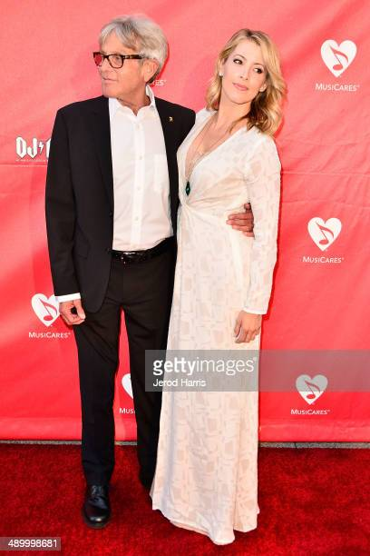 Jeff Greenberg and Athena Perez arrive at the 2014 MusiCares MAP Fund Benefit Concert at Club Nokia on May 12 2014 in Los Angeles California