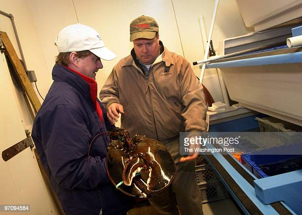 Jeff Grolig of River Falls Seafood delivers an 18 pound lobster to Kurt Friesland of JJ McDonnell in Jessup A woman purchased the lobster for $15000...