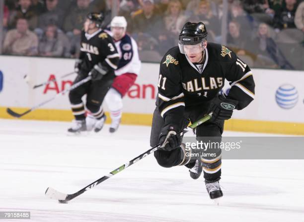 Jeff Halpern of the Dallas Stars handles the puck against the Columbus Blue Jackets at the American Airlines Center on January 19, 2008 in Dallas,...
