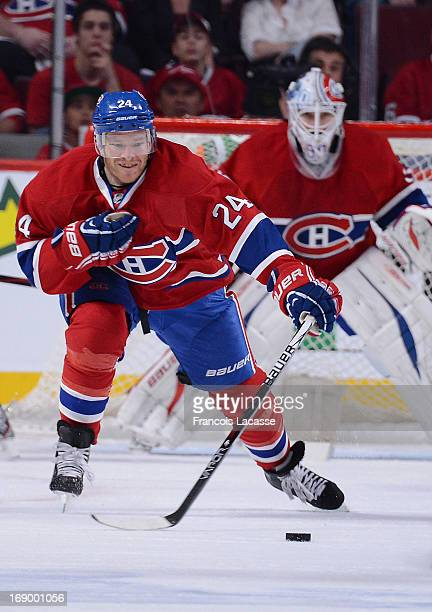Jeff Halpern of the Montreal Canadiens defends against the Ottawa Senators in Game Five of the Eastern Conference Quarterfinals during the 2013 NHL...