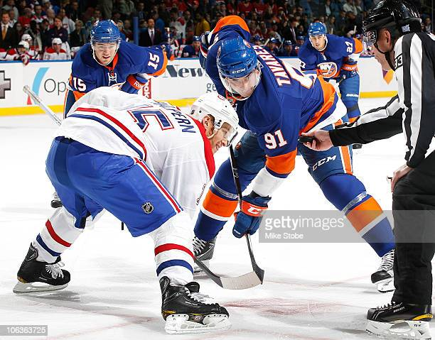 Jeff Halpern of the Montreal Canadiens faces off against John Tavares of the New York Islanders on October 29 2010 at Nassau Coliseum in Uniondale...