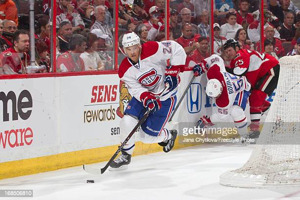 Jeff Halpern of the Montreal Canadiens skates with the puck in Game Four of the Eastern Conference Quarterfinals against the Ottawa Senators during...