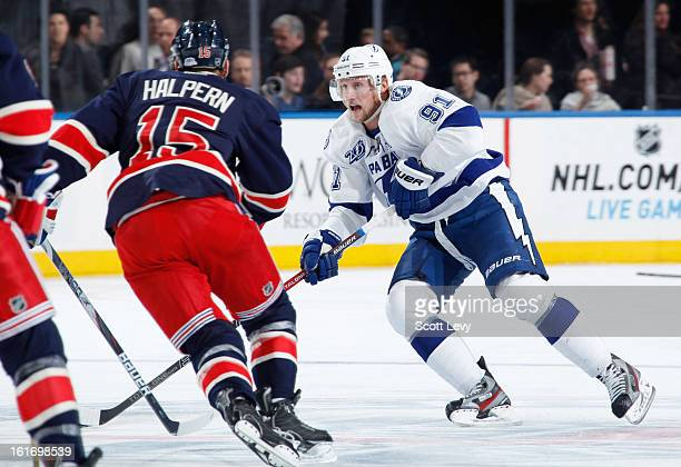 Jeff Halpern of the New York Rangers defends against Steven Stamkos of the Tampa Bay Lightning at Madison Square Garden on February 10 2013 in New...