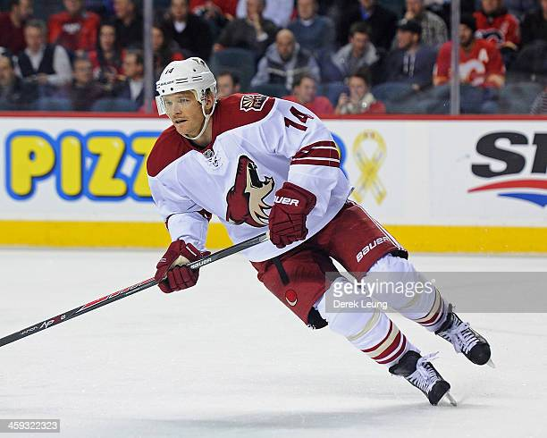 Jeff Halpern of the Phoenix Coyotes skates against the Calgary Flames during an NHL game at Scotiabank Saddledome on December 4 2013 in Calgary...