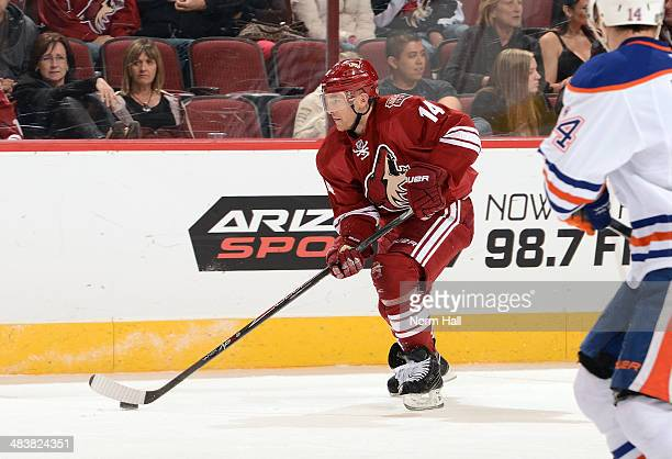 Jeff Halpern of the Phoenix Coyotes skates with the puck against the Edmonton Oilers at Jobingcom Arena on April 4 2014 in Glendale Arizona