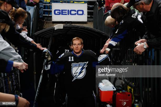 Jeff Halpern of the Tampa Bay Lightning greets fans as he walks out to the bench before the start of the game against the Montreal Canadiens at the...