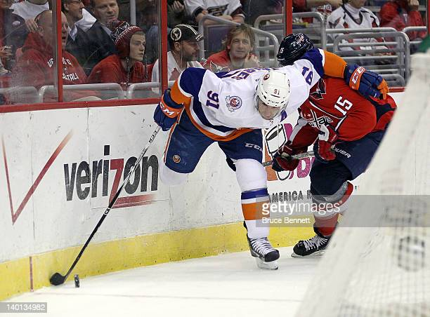 Jeff Halpern of the Washington Capitals holds up John Tavares of the New York Islanders at the Verizon Center on February 28 2012 in Washington DC