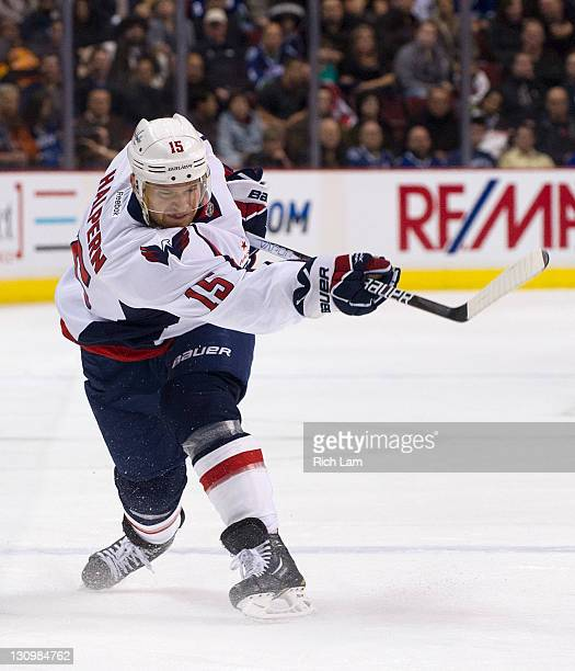 Jeff Halpern of the Washington Capitals shoots the puck during NHL action against the Vancouver Canucks on October 29 2011 at Rogers Arena in...