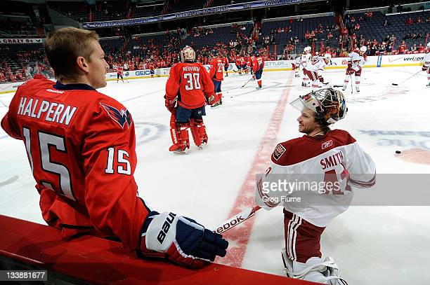 Jeff Halpern of the Washington Capitals talks with Mike Smith of the Phoenix Coyotes before the game at the Verizon Center on November 21 2011 in...