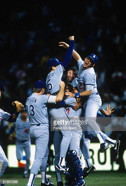 Jeff Hamilton Orel Hershiser Rick Dempsey Mickey Hatcher and Tracy Woodson of the Los Angeles Dodgers meet on the mound to celebrate winning the...