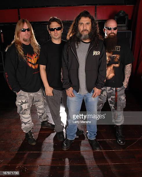 Jeff Hanneman Dave Lombardo Tom Araya and Kerry King of Slayer pose for a photo session at club Revolution on February 24 2007 in Ft Lauderdale...