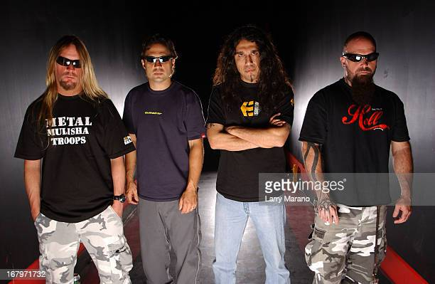 Jeff Hanneman Dave Lombardo Tom Araya and Kerry King of Slayer pose for a portrait at Revolution on May 11 2002 in Fort Lauderdale Florida