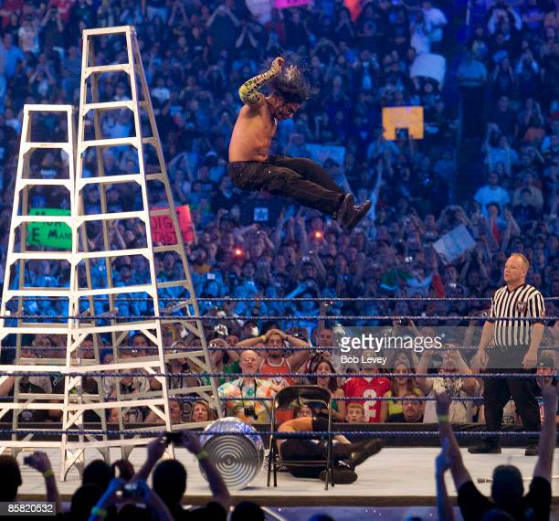 Jeff Hardy leaps off a ladder onto the body of brother Matt during an extreme rules match at WrestleMania 25 at the Reliant Stadium on April 5 2009...