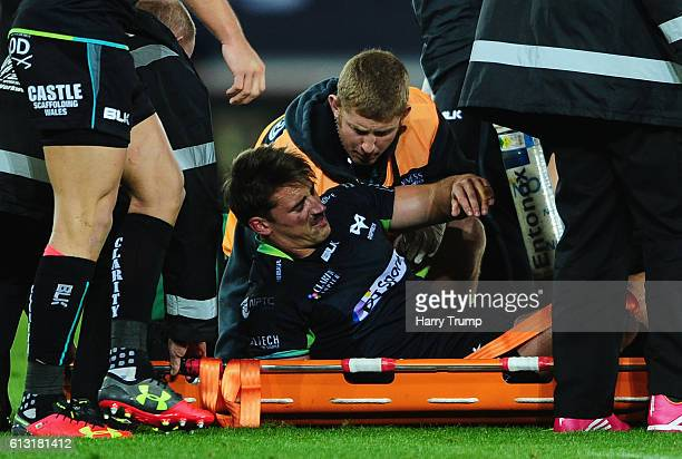 Jeff Hassler of the Ospreys is stretchered off through injury during the Guiness Pro12 match between the Ospreys and Cardiff Blues at the Liberty...