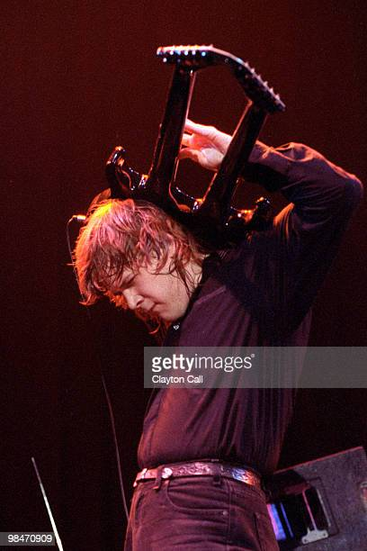 Jeff Healey performing at the Warfield Theater in San Francisco on September 9, 1990. He plays the guitar behind his head.