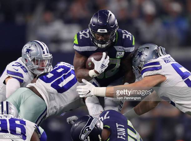 Jeff Heath Demarcus Lawrence and Leighton Vander Esch of the Dallas Cowboys combine to stop Chris Carson of the Seattle Seahawks in the third quarter...