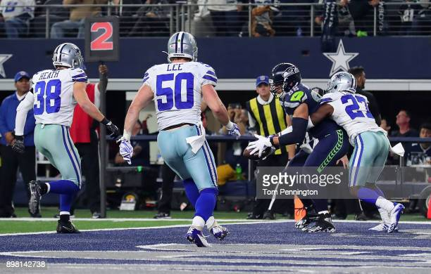 Jeff Heath of the Dallas Cowboys Sean Lee of the Dallas Cowboys and Jourdan Lewis of the Dallas Cowboys are unable to keep Jimmy Graham of the...