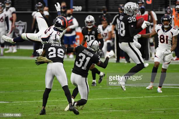 Jeff Heath of the Las Vegas Raiders intercepts a pass intended for K.J. Hamler of the Denver Broncos during the first quarter at Allegiant Stadium on...