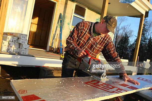 Jeff Heck an employee with Graves Builders cuts a piece of insulation board at a home construction site in Peacham Vermont US on Tuesday Oct 30 2007...