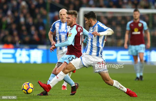 Jeff Hendrick of Burnley and Christopher Schindler of Huddersfield Town battle for possession during the Premier League match between Huddersfield...