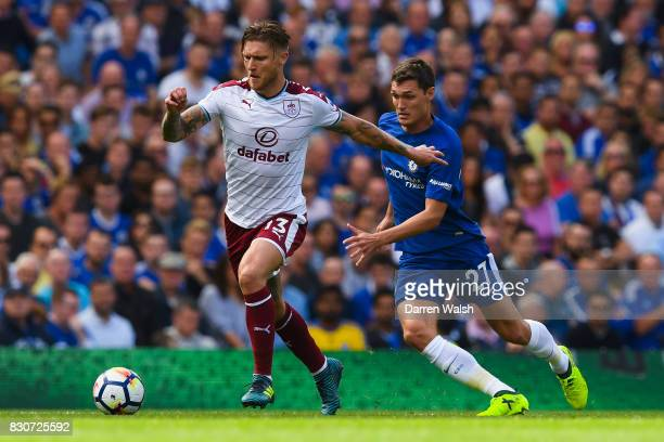 Jeff Hendrick of Burnley attempts to get away from Andreas Christensen of Chelsea during the Premier League match between Chelsea and Burnley at...